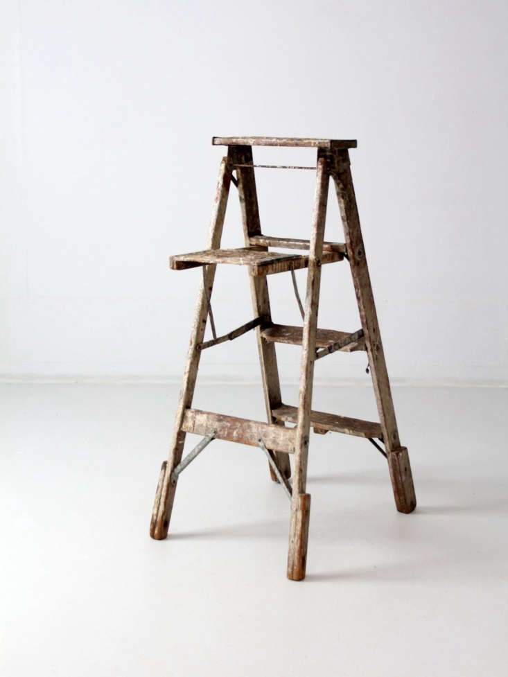 A three-rung woodenVintage Painter's Ladder has metal hinges and &#8\2\20;heavy patina and paint splatter.&#8\2\2\1; It is \$560 from 86home via Etsy.