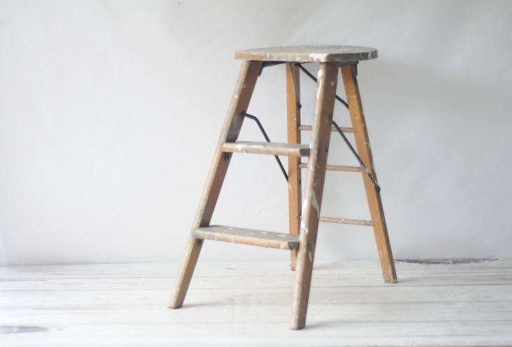 A vintage Wood Crackerjac Step Ladder manufactured by the Chicago Curtain Stretcher Company may date to the \19\10s and is \$88 from PageScrappers via Etsy.