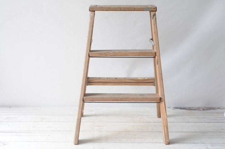 A folding Vintage Wood Step Ladder is \$49.99 from PageScrappers via Etsy.