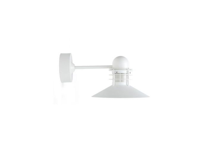 A Nyhavn Outdoor Wall Sconce designed by Alfred Homann and Ole V. Kjær for Louis Poulsen Lighting is \$\1,4\28 from Design Within Reach.