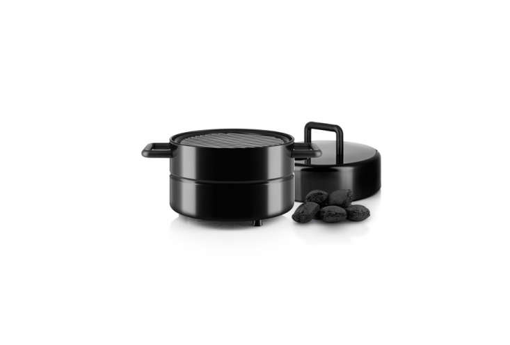 The Eva Solo To Go Grill is compact and each element stacks on one another and fastens with a polyester band around the entire unit; €\160 (\$\186 USD) at Connox.