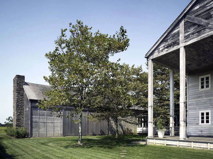 """Photograph by Nikolas Koenig.Set on a \17-acre expanse on eastern Long Island, this artist's compound by Annabelle Selldorf was """"inspired by typical New England farm structures; the house, studio, garage, and pool pavilion form a quartet of taut, shingled and gabled volumes arranged around a central courtyard. The structures are positioned to provide a series of outdoor rooms."""""""