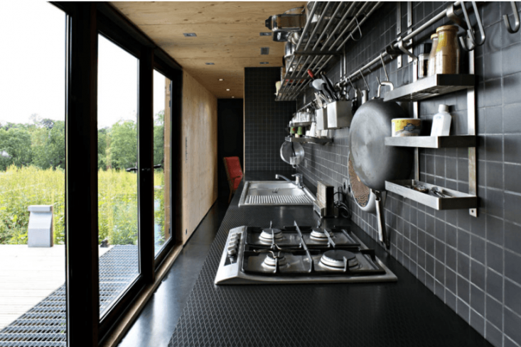 A galley kitchen opens onto a deck.