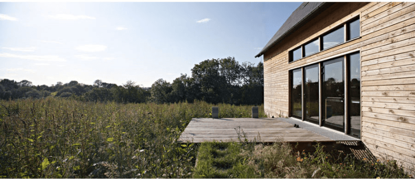 A simple wooden deck floats in a meadow. For more of this project, see Architect Visit: Lode Architecture in Normandy.