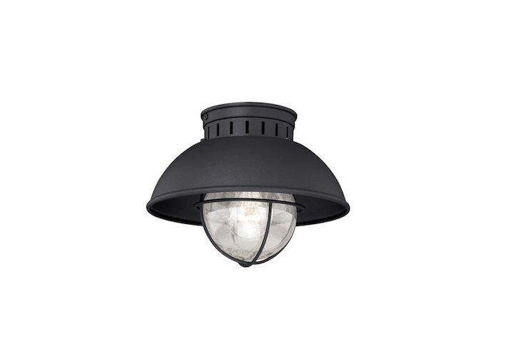 Made of steel and rated for use in a damp exterior location, an Archibald Flush Mount has a seeded glass globe and is \$69.99 from Wayfair.