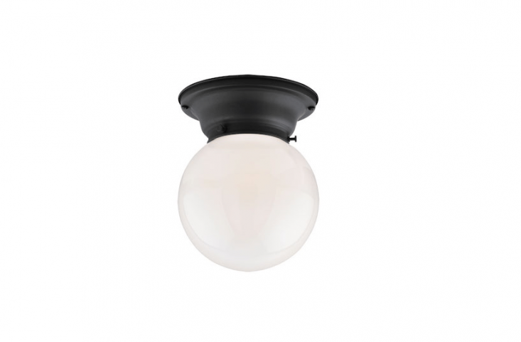 A Thurman Ceiling Fixture with a brass body is made in Oregon; available in nine finishes including oil-rubbed bronze as shown, it can be customized with \1 different shades. As shown with a 6-inch Classic Ball Shade in opal glass, the fixture is \$\130.