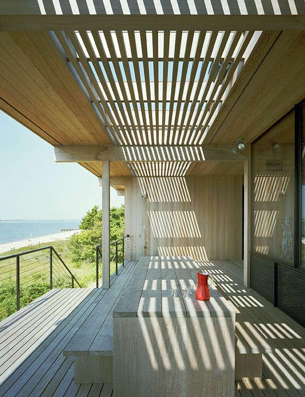 Summer sun slits through Cary Tamarkin's Shelter Island porch