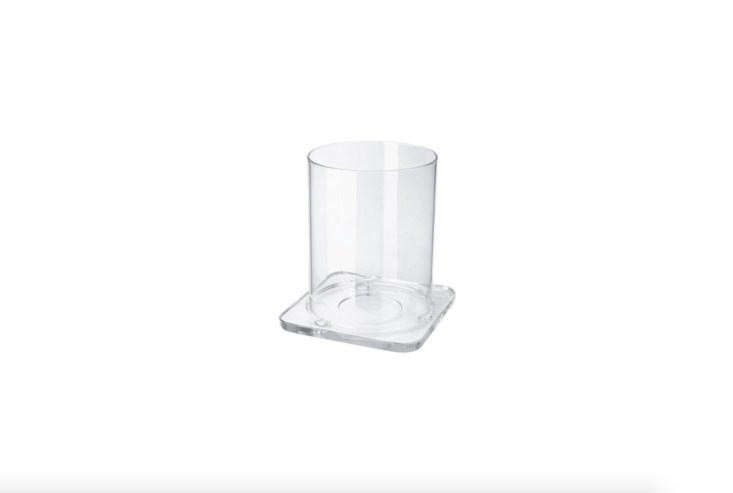 Michelle protects candle flames from wind with clear glass Glasig Lanterns from Ikea; \$9.99 each.
