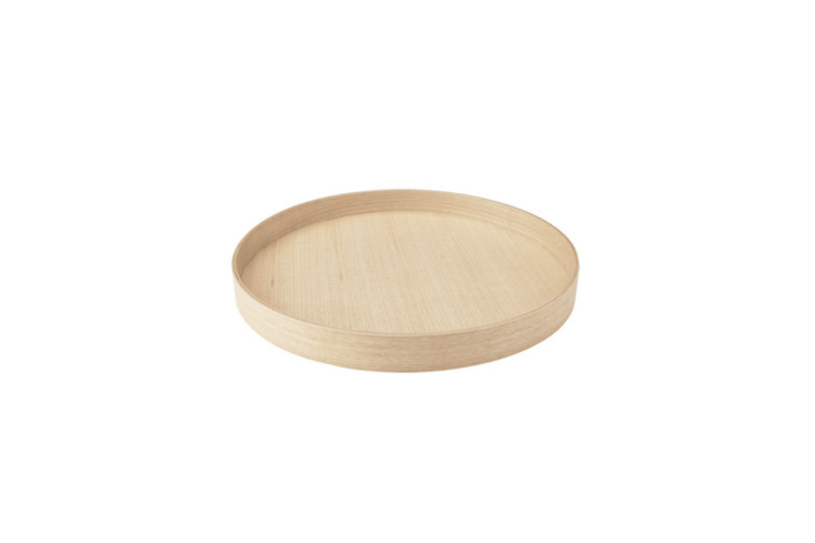 Janet is devoted to the Stockholm Serving Tray from Ikea; made of clear lacquered ash veneer, it measures \20 inches in diameter; \$34.99.