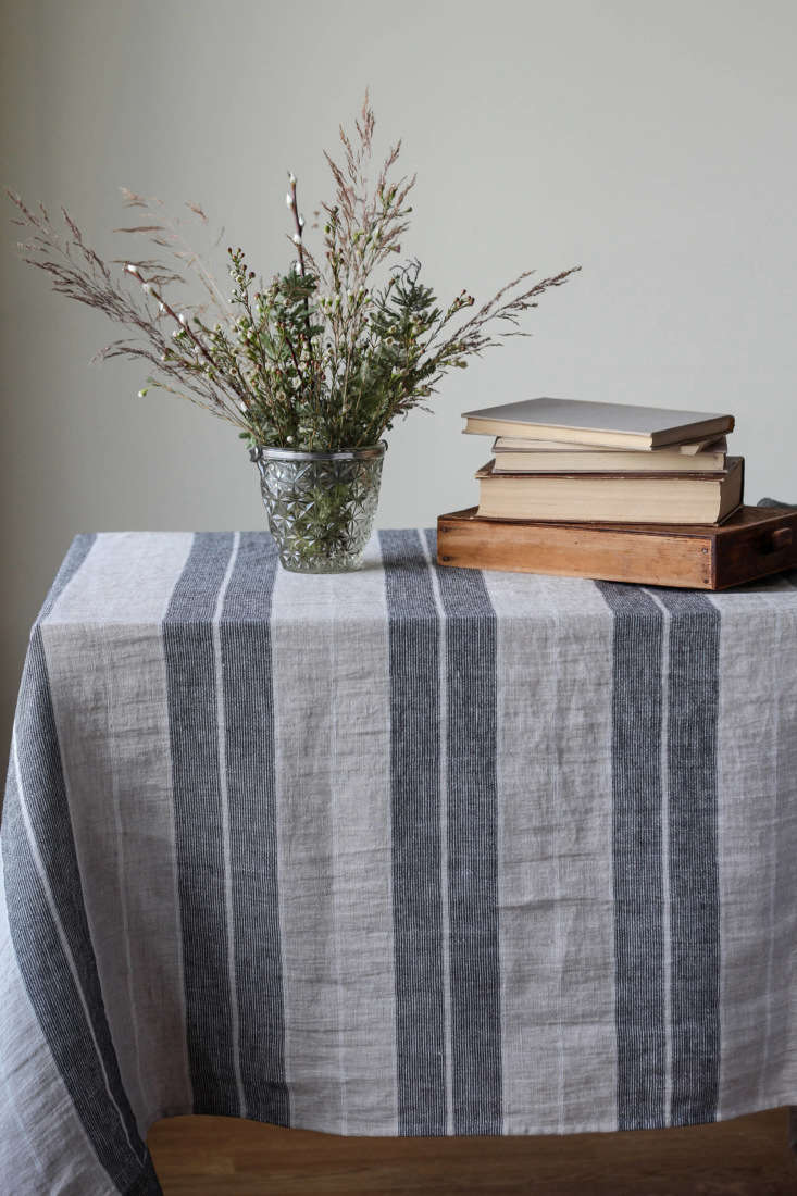 Francesca likes theNatural Linen Table Cloth with black stripes, which is available in several sizes, starting at 55 by 80 inches;\$73.8\1 from Alabatis via Etsy.