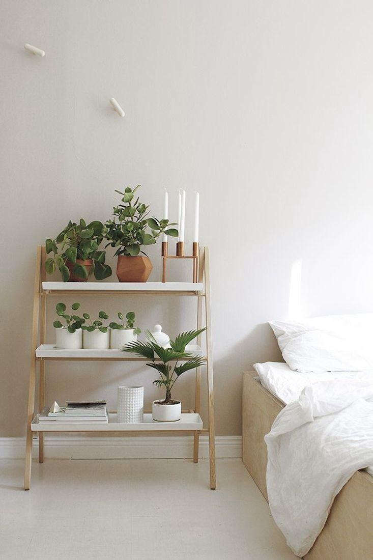 A foldable tabletop stepladder designed by Klaus Aalto has three shelves. And many different uses: bedside table, kitchen herb garden, and entryway console. Photograph via Kekkila.