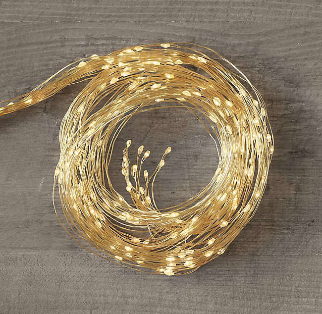 Available in either silver or gold as shown,Waterfall Starry String Lights are available in two lengths—3 and 6 feet— and are from \$47 to \$69 per string depending on length at Restoration Hardware.