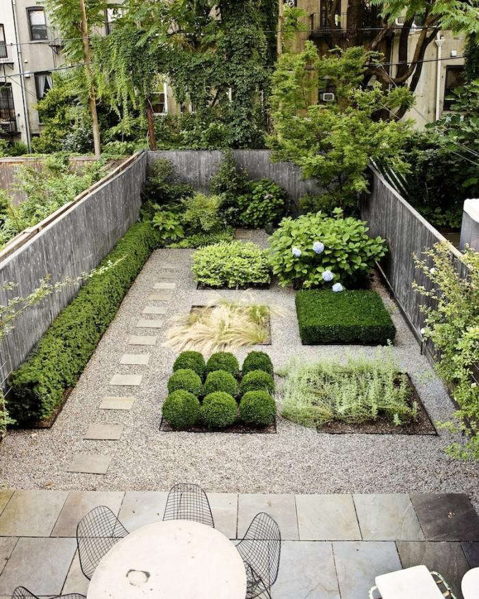 This geometric gardenin a Brooklyn backyard,designed by Susan Welti ofForas Studio, features bluestone pavers and pea gravel.