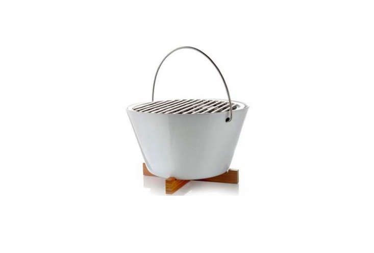 The compact Eva Solo Table Grill from Danish designers Claus Jensen and Henrik Holbaek is ideal for urban outdoor spaces. The wooden base protects your outdoor table from the heat; after grilling, the bowl, rack, and insert can be put in the dishwasher for easy cleanup; \$\269 at Amazon.