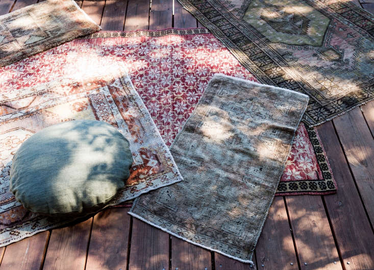 Layered kilim rugs transform the deck of a platform tent into an outdoor living room in Napa. See more of this project in our Gardenista book. Photograph by Matthew Williams.