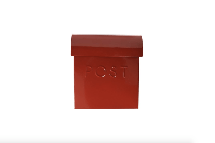 A red wall-mounted Euro Mailbox made of metal is powder-coated for rust protection; available in seven colors, from \$38.\2\2 via Amazon.