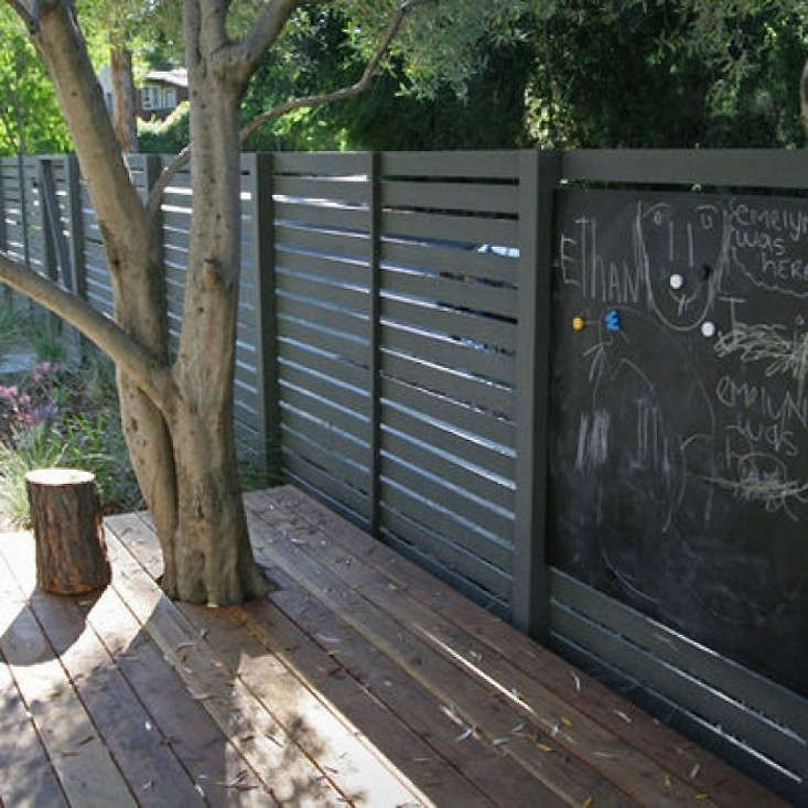 A chalkboard is incorporated into the design of a fence by Shades of Green. Photograph courtesy of Shades of Green. For more, see Fence Fashion: src=