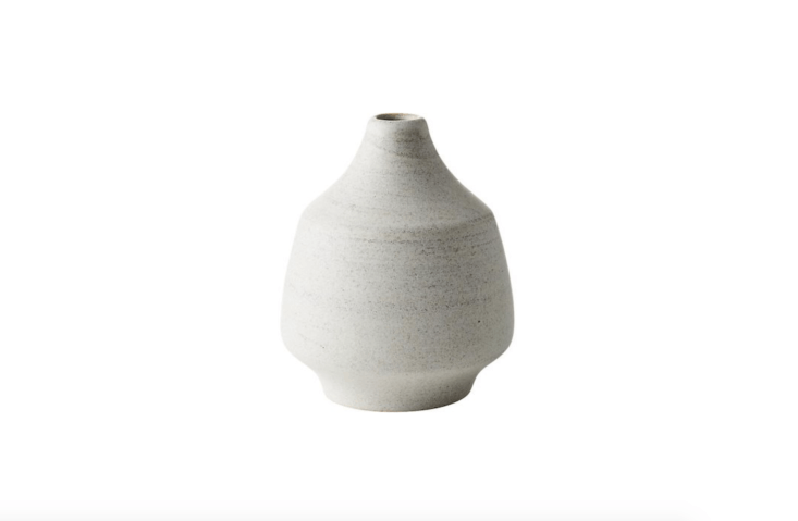 A stonewareLunar Ivory Vase is 5.\25 inches tall; \$9.95 from CB\2.