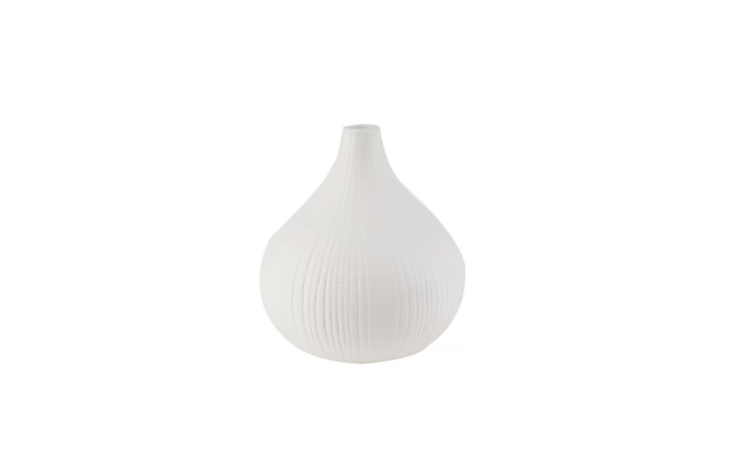 A white ceramicWoven Vase is eight inches tall; \$59.99 from All Modern.