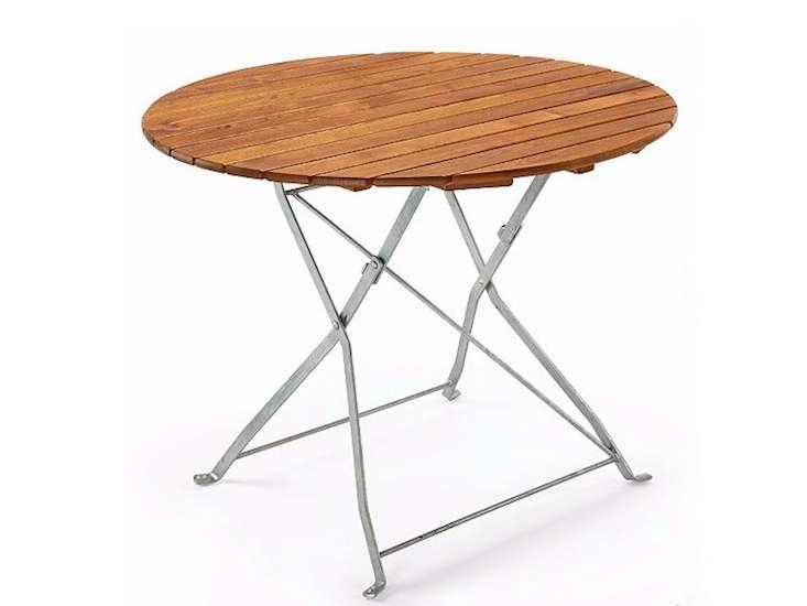 beer-garden-round-outdoor-dining-table-gardenista