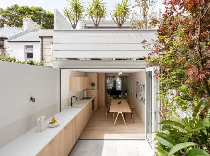 "In their remodel of a ""dark and unpleasant inner-city terrace house"" in a suburb of Sydney, Australia, architecture firm Benn + Penna introduced a kitchen addition that blurs the lines between indoors and out. See more in Architect Visit: An Indoor-Outdoor Kitchen in Sydney, Australia. Photograph courtesy of Benn + Penna Architecture."