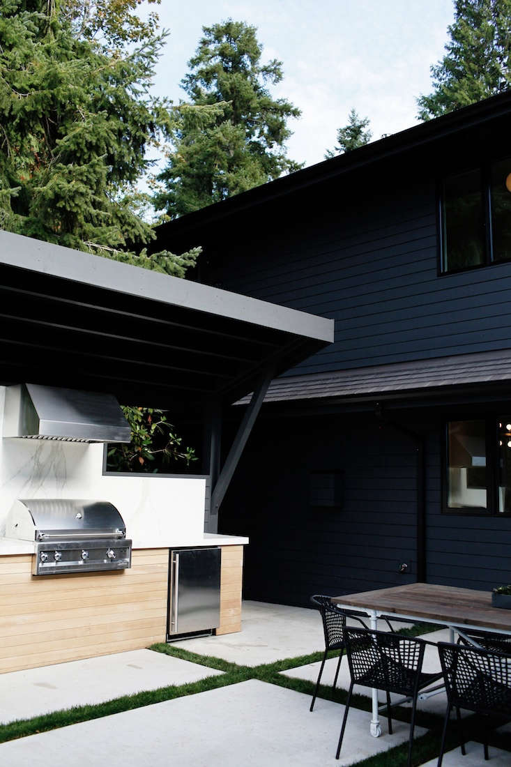 In a Seattle outdoor kitchen, appliances include an Artisan gas grill, U-Line refrigerator, and Broan hood. For more, see Sleekness in Seattle: Modern Garden, Midcentury House. Photograph courtesy of Belathée Photography.