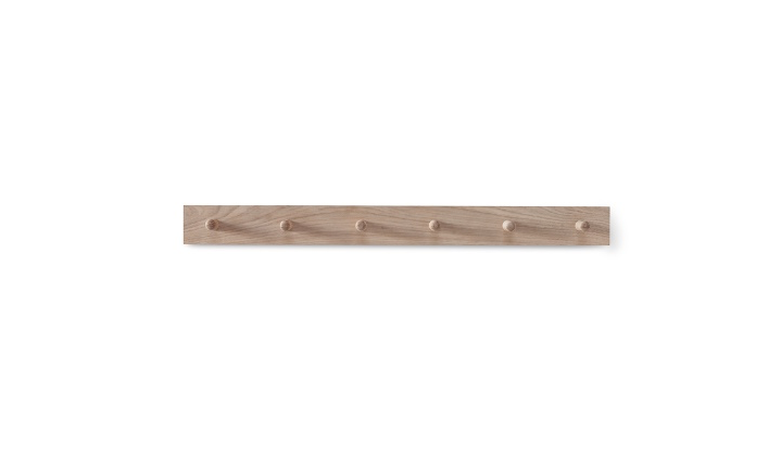 AnOak Peg Rail available in two lengths (with three or six hooks) is £30 to £45 from Cox & Cox depending on size.