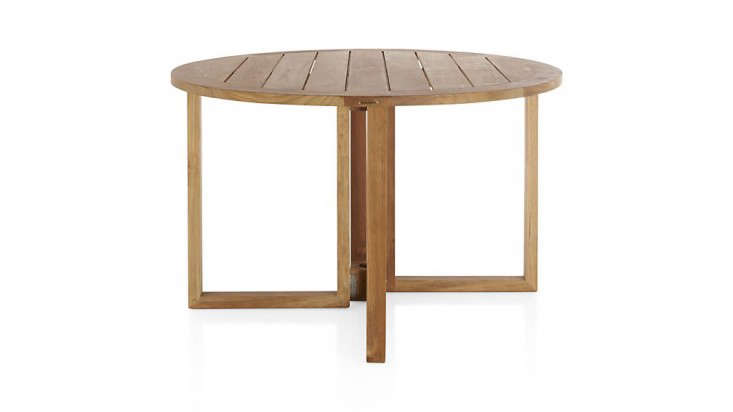 round-wood-outdoor-dining-table-gardenista