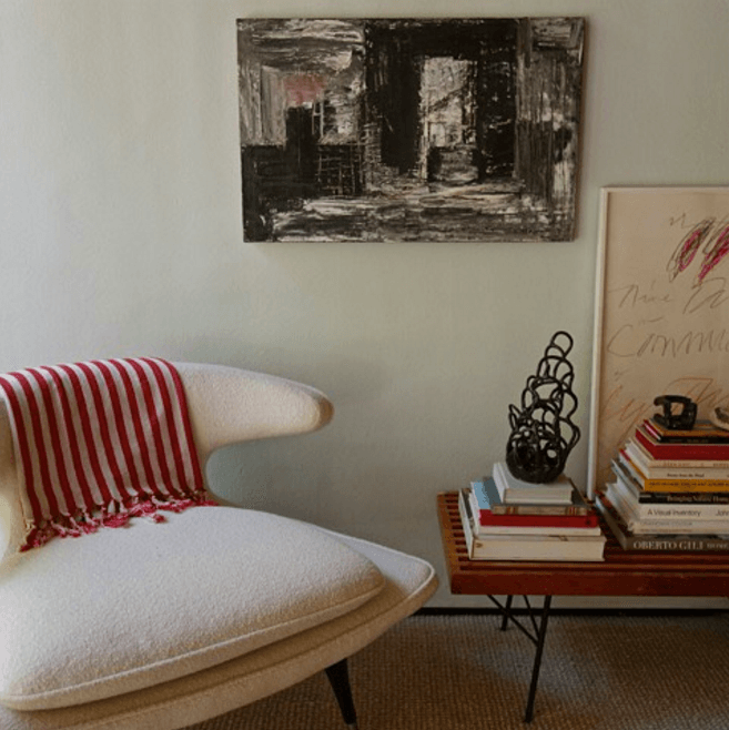 Master Bedroom, Santa Monica: Across from the previous photo, this corner shows a vintage Karpen chair, with a personal collection of art and books, against a pale blue accent wall. Photo: Laura Clayton Baker