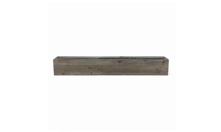 A 30-inch-long Rectangular Wood Planter box has a removable zinc liner. It is $50 from ModernVase via Etsy.