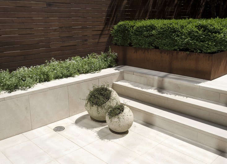 Available in several colors, finishes (including Honed, Flamed, Sandblasted, Polished, and Bush Hammered) and sizes, limestone pavers also can be mounted on vertical surfaces to create a seamless transition from patio to retaining walls. For specs and pricing, see Valders Stone & Marble. Photograph by Matthew Williams.