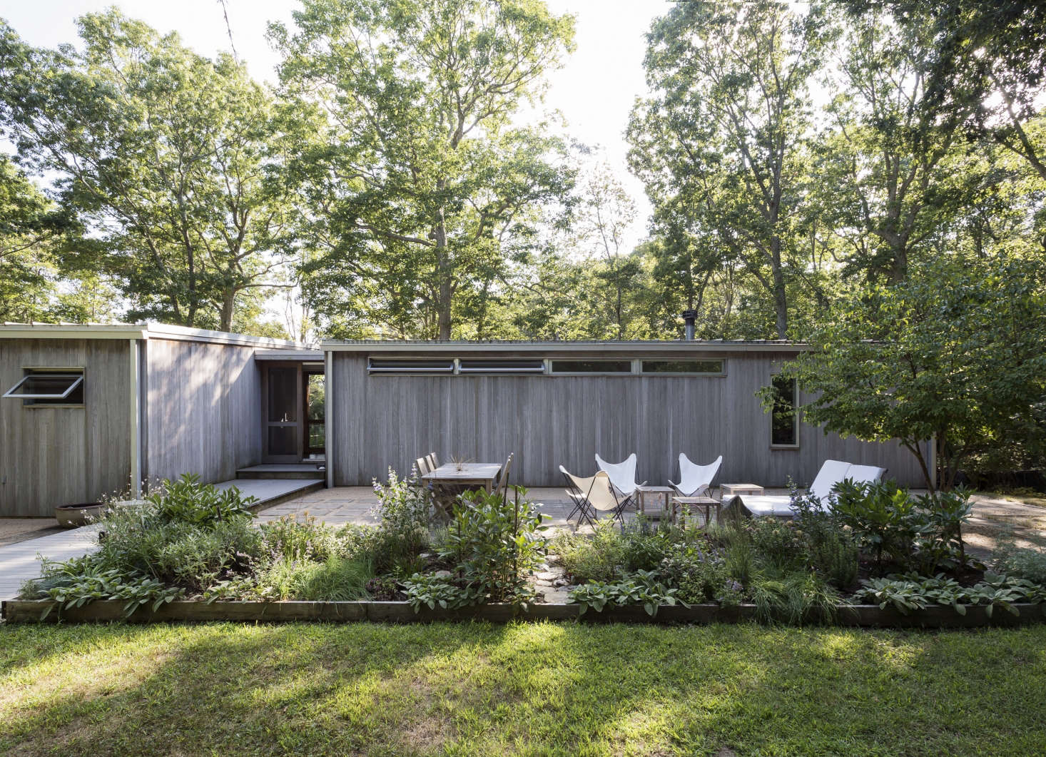 On Shelter Island, Suzanne Shaker and Pete Dandridge designed a patio with square concrete pavers set in a permeable based of decomposed granite. See more of the project in our new Gardenista book. Photograph by Matthew Williams for Gardenista.