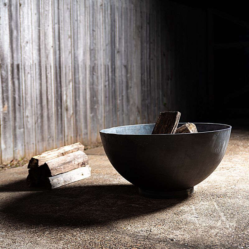 We love the rice bowl proportions of the cast iron Hemisphere Fire Pit. The -inch version, pictured, is currently out of stock; the 4