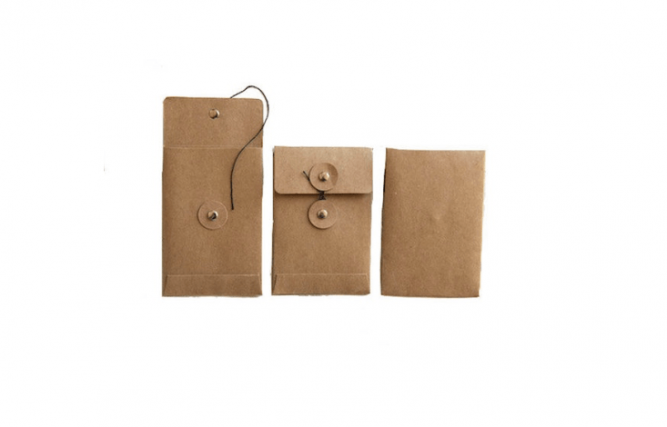 A set of \25 Brown Kraft Paper Seed Packets with cord clasps is \$9.50 from Goldberg Gartenschatz via Etsy.