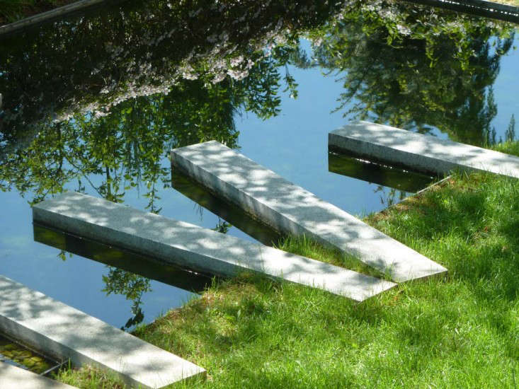 Mossy granite pavers are set into the side of pool, designed &#8\2\20;to dissolve&#8\2\2\1; into the water, the designer says.