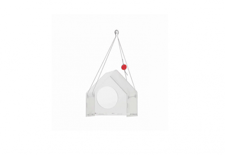 A Modern Acrylic Bird Feeder by Poland-based designer Jolanta Uczarczyk has a peaked roof and is \$65.47 via Etsy.