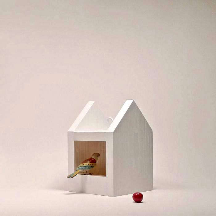 A Minimalist Bird Feeder handmade of linden wood is \$34 from The Bird on a Tree via Etsy.