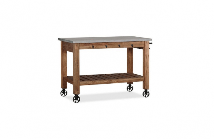 With a solid acacia base and a concrete worktop, anAbbott Island is a potting table on castors, to make it easy to move indoors or out; $loading=