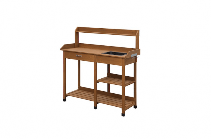 ADeluxe Potting Bench with a drawer, two shelves, and a dry sink is $77. from Amazon.