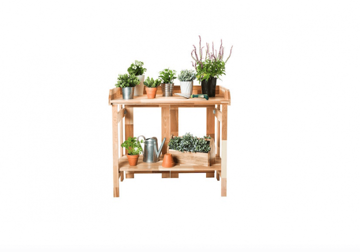 Built of rot-resistant cedar, an Outdoor Potting Bench folds flat for storage; $