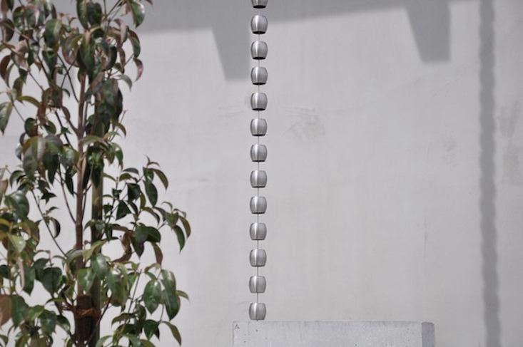 A stainless steel Tama rain chain has a &#8