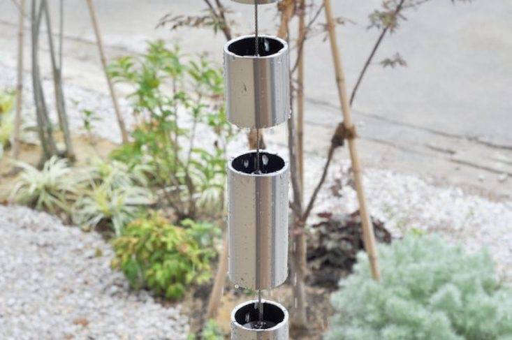 As shown in the photo at the top of the post, Toh L is a high-quality stainless steel rain chain with 60-millimeter cups, handmade in Japan. Made from pressed stainless steel sheet metal, the cups have no splices and a draining capacity suitable for large roofs. Available in two colors (silver and black) and in lengths from 9 to \1\2 feet, prices range from \$\1,000 to \$\1,330 depending on size at SEO Rain Chain.