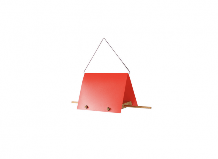 Germany-based designer Anton Preis&#8\2\17;s Bird Feeder Housefor Design im Dorf has a wooden feeding platform protected by a red stainless steel roof; \$65.90 from Connox.