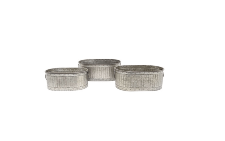 A set of three Galvanized Metal Trough Planters with handles is \$\189.99 from Hayneedle.