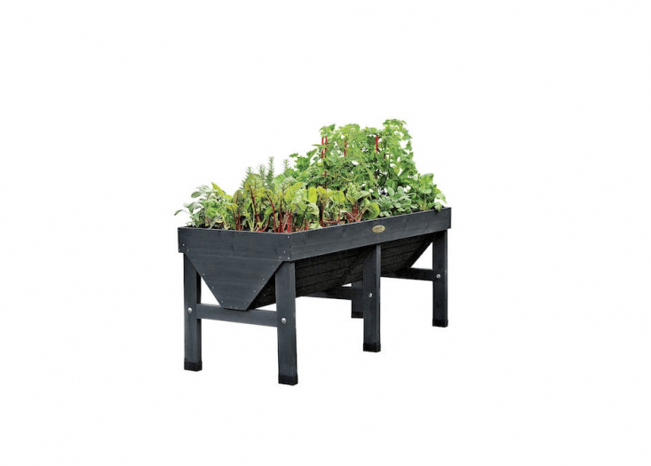 Above: Add an instant vegetable garden on your patio or balcony with the VegTrug Elevated Planter. A generous 70 inches long, 30 inches wide, and 30.5 inches tall, it has a V-shape base that enables planting of deep root plants (tomatoes, carrots, etc.) in the center and shallow-rooted growers on the sides. It includes a fitted fabric liner to keep soil contained while letting excess water drain. Shown in charcoal, it is \$\299 at Gardener&#8\2\17;s Supply.