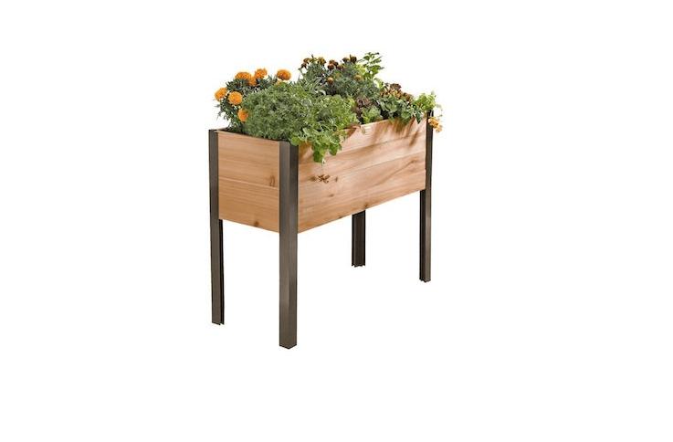 A Rolling Cedar Patio Garden is made of cedar with powder coated aluminum legs; $9 from Gardener&#8