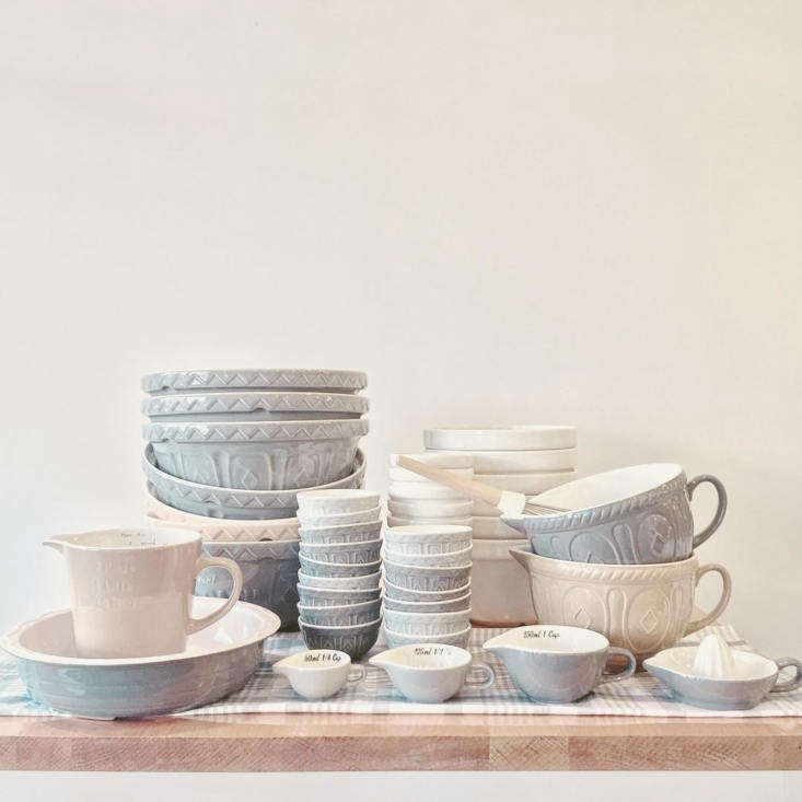 A collection of Mason Cash pottery in shades of cream and gray on display at Les Touilleurs in Montreal.