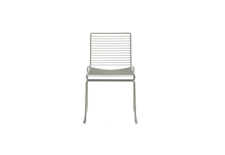 A Stackable Hee Dining Chair, available in seven colors including a soft Fall Green (shown), is \$\265 at A & R
