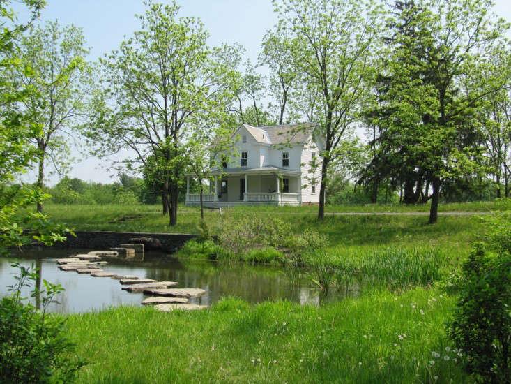 Wisniewski-white-farmhouse-bluestone-pavers-pond-hudson-valley-landscape