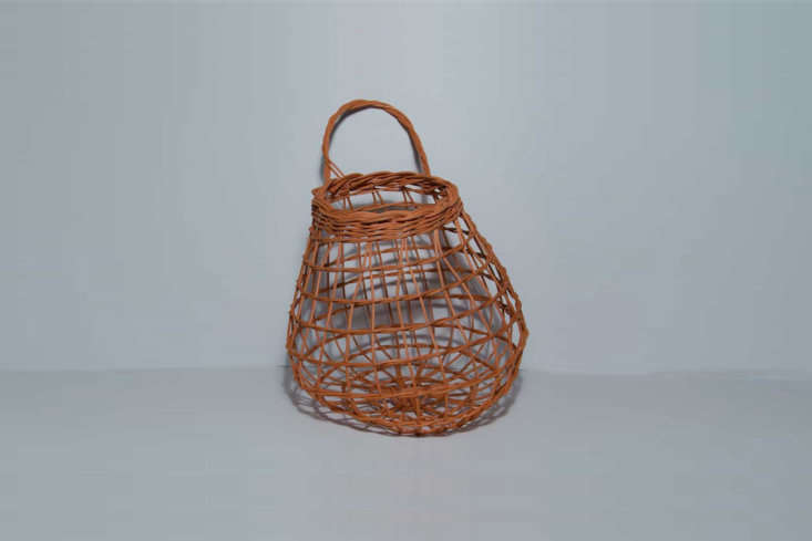 From Etsy seller Justa Bunch of Baskets, the Rust Onion Basket made of hand-dyed round reed, is \$65.